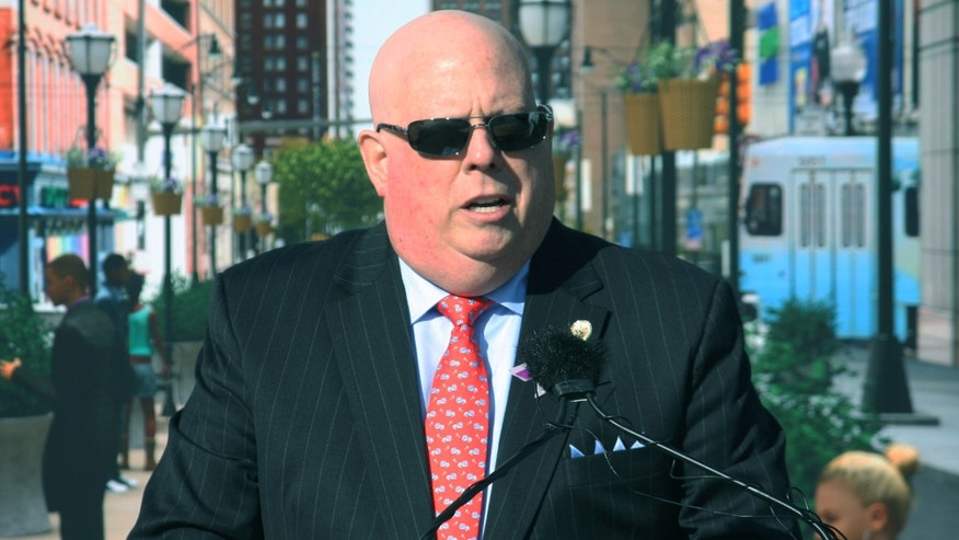 Oct. 22, 2015: Maryland Gov. Larry Hogan announces a $135 million plan to redesign Baltimore's transit system during a news conference at a commuter train station, where he spoke in front of a backdrop of a city scene.