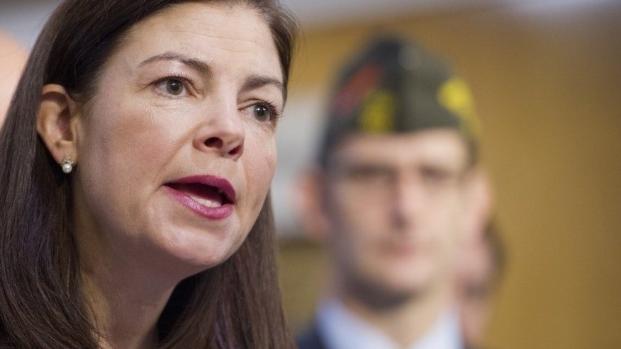 UNITED STATES - Dec 17: Leaders from several military and veterans service organizations joined Sen. Kelly Ayotte , R-NH., at a press conference to urge Senators to use alternative savings to replace a provision in the budget proposal that cuts retirement benefits for current and future military retirees.  In a letter to their Senate colleagues on Friday, Graham, Ayotte, and Wicker called for a bipartisan solution to replace the $6.3 billion in cuts to military retiree benefits. (Photo: Douglas Graham via Getty Images)