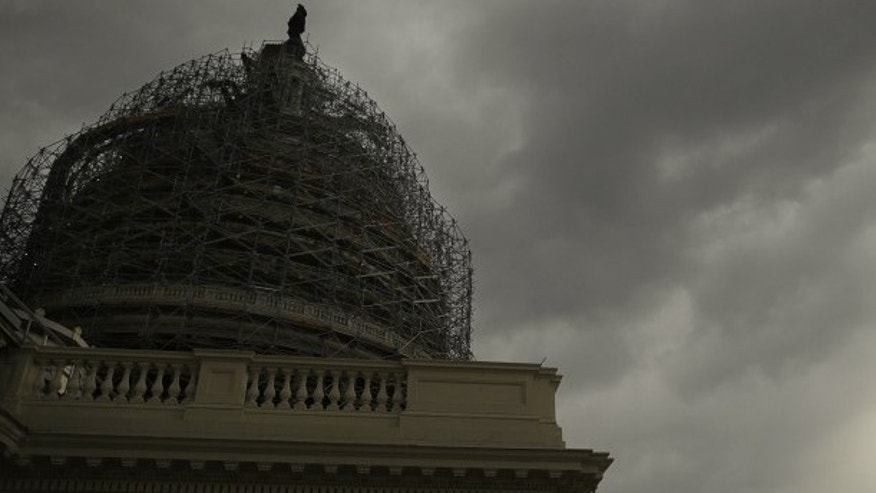 Storm clouds approach the U.S. Capitol dome during a day of rain in Washington Nov. 6, 2014.   (REUTERS/Gary Cameron)