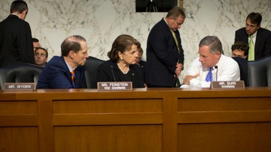 FILE - In this Sept. 24, 2015 file photo, Senate Intelligence Committee Chairman Sen. Richard Burr, R-N.C., right, confers with committee Vice-Chair. Sen. Dianne Feinstein, D-Calif., center, and committee member Sen. Ron Wyden, D-Ore., on Capitol Hill in Washington. (AP Photo/Pablo Martinez Monsivais)