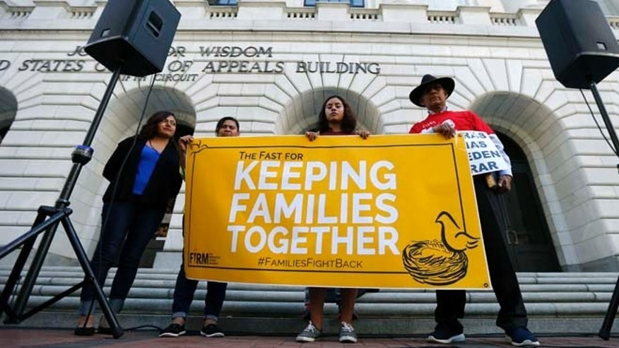 Immigration activists protest outside the federal appeals court in New Orleans, Wednesday, Oct. 14, 2015. The activists are accusing the federal appeals court in New Orleans of delaying a ruling about President Barack Obama's immigration proposal in an effort to prevent it from reaching the U.S. Supreme Court during the current term. Left to right are Nora Hernandez, of Albuquerque, N.M., Myrta Venture, of Silver Spring, Md., Mayra Jannet Ramierz, of Mountain Hope, Ark. and Miguel H. Claros, of Silver Spring. (AP Photo/Gerald Herbert)