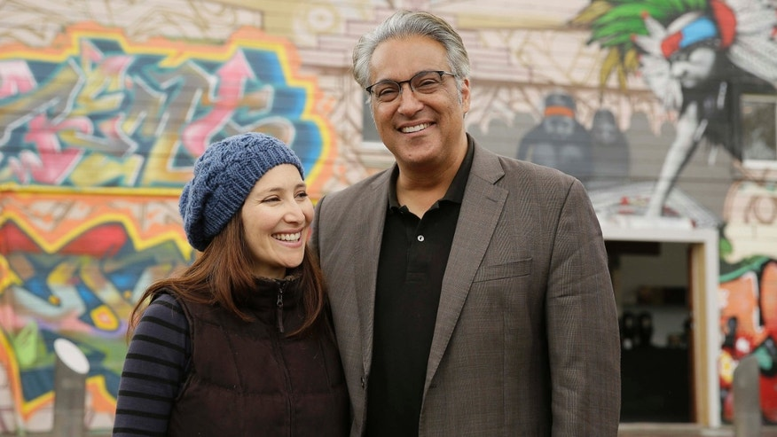 In this Wednesday, Oct. 28, 2015, photo, San Francisco Sheriff Ross Mirkarimi poses with his Venezuelan-born wife, Eliana Lopez, outside a Mission District coffee bar in San Francisco.