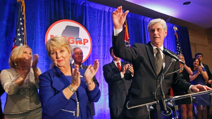 Nov. 3, 2015: Republican Gov. Phil Bryant, right, and wife Deborah acknowledge friends and supporters during an election day party in Jackson, Miss.