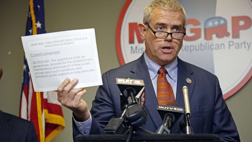 """Oct. 27, 2015: House Speaker Philip Gunn, R-Clinton, argues against Initiative 42, a proposed constitutional amendment that would require the state to provide """"an adequate and efficient system of public schools,"""" during a news conference in Jackson, Miss."""