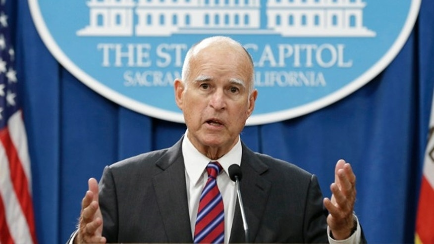 FILE - In this Wednesday, Sept. 9, 2015, file photo, California Gov. Jerry Brown gestures during a news conference in Sacramento. Brown directed state oil and gas regulators to investigate the oil and gas potential of his family's ranch land in Northern California, state records obtained by the Associated Press show. (AP Photo/Rich Pedroncelli, File)