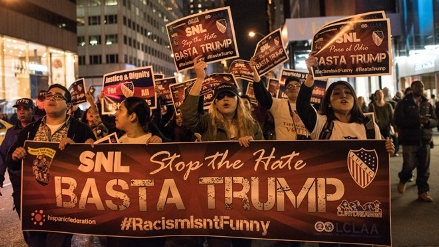 NEW YORK, NY - NOVEMBER 7: Members of Latino organizations march from the Trump Tower to NBC studios during a rally against Republican Presidential candidate Donald Trump on November 7, 2015 in New York City. Trump is set to host NBC's Saturday Night Live, and has faced criticism during the campaign for his proposed immigration policies. (Photo by Andrew Renneisen/Getty Images).