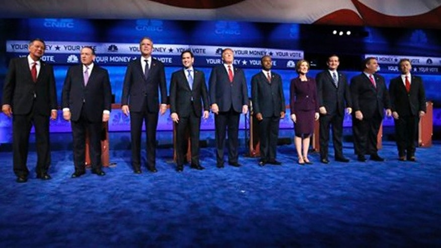 Oct. 28, 2015: Republican presidential candidates, from left, John Kasich, Mike Huckabee, Jeb Bush, Marco Rubio, Donald Trump, Ben Carson, Carly Fiorina, Ted Cruz, Chris Christie, and Rand Paul take the stage during the CNBC Republican presidential debate at the University of Colorado.