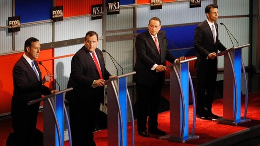 Nov. 10, 2015: (fr. left.) Rick Santorum, Chris Christie, Mike Huckabee and Bobby Jindal at GOP presidential debate at Milwaukee Theatre, in Wisc.