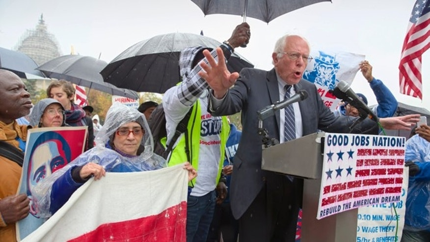 Democratic presidential candidate, Sen. Bernie Sanders, I-Vt. joins low-wage workers, some who labor as cooks and cleaners at the Capitol, as he speaks during a rally to protest what they describe as poverty pay, Tuesday, Nov. 10, 2015, on Capitol Hill in Washington.  (AP Photo/J. Scott Applewhite)