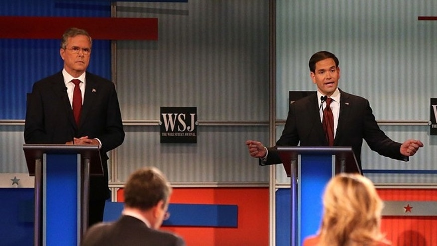 MILWAUKEE, WI - NOVEMBER 10:  Republican presidential candidates Jeb Bush (L) and Donald Trump (R) look on as U.S. Sen. Marco Rubio (R-FL) speaks during the Republican Presidential Debate sponsored by Fox Business and the Wall Street Journal at the Milwaukee Theatre on November 10, 2015 in Milwaukee, Wisconsin. The fourth Republican debate is held in two parts, one main debate for the top eight candidates, and another for four other candidates lower in the current polls.  (Photo by Scott Olson/Getty Images)