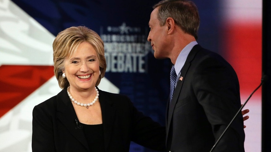 Nov. 14, 2015: Hillary Rodham Clinton shakes hands with Martin O'Malley after a Democratic presidential primary debate in Des Moines, Iowa.
