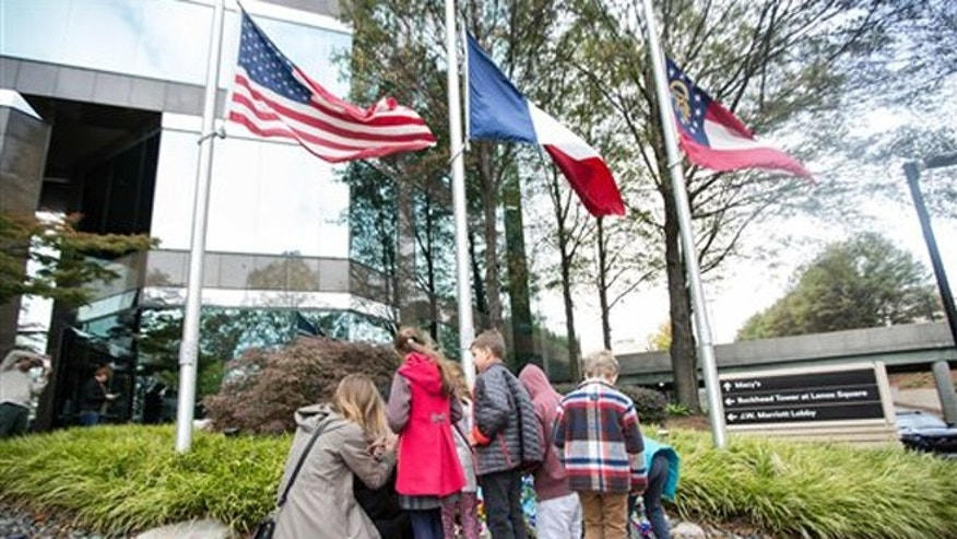 Nov. 15, 2015: People gather around a makeshift memorial outside at the Consulate General of France in Atlanta.