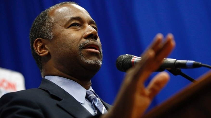 Republican presidential candidate Ben Carson speaks at a news conference after a rally Sunday, Nov. 15, 2015, in Henderson, Nev. Carson spoke at a church in Las Vegas earlier in the day before speaking to a crowd at the rally in Henderson, Nev.  (AP Photo/John Locher)