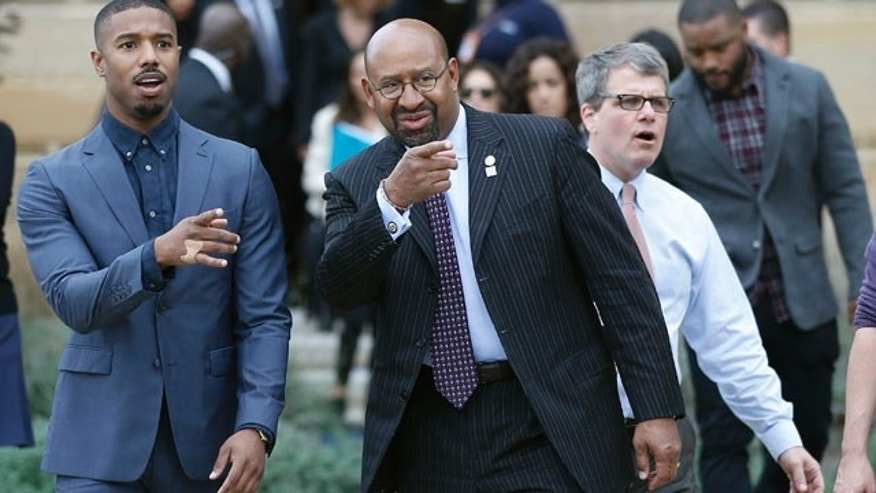 Nov. 6, 2015: Actor Michael B. Jordan, left, and Philadelphia Mayor Michael Nutter gesture as they walk to a press conference promoting the film 'Creed' outside the Philadelphia Museum of Art. (AP Photo/Matt Slocum)