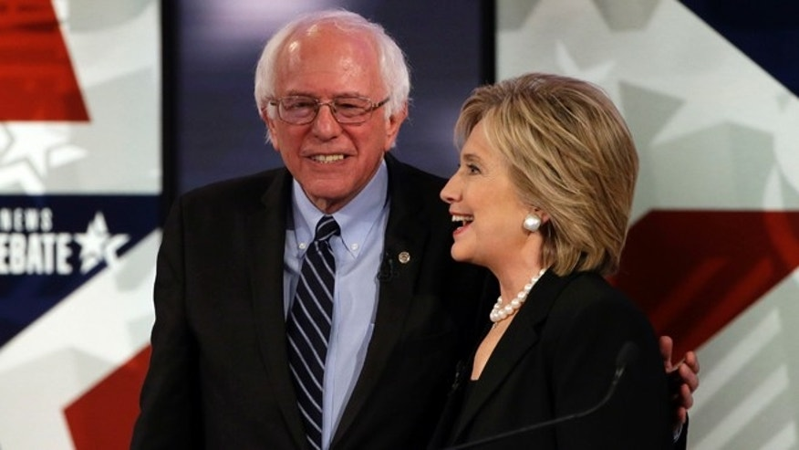 Nov. 14, 2015: Hillary Rodham Clinton, right, talks to Bernie Sanders after a Democratic presidential primary debate in Des Moines, Iowa.