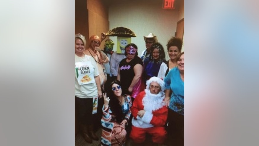 TRICK OR TREAT: VA workers dress up for Halloween, including Jeremy Pottle, second from left, and Lisa Benner, third from right (standing).