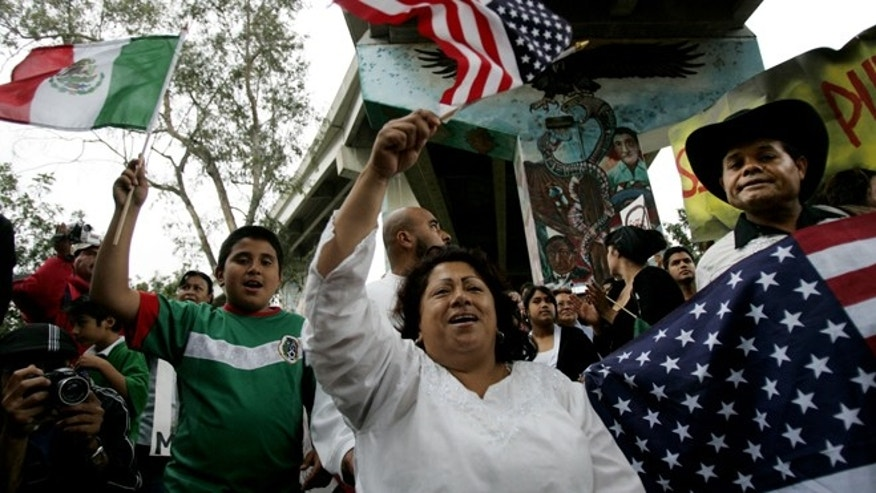 "SAN DIEGO, CA- MAY 1:  Demonstrators chant ""Si Se Puedes"" during an immigration march on May 1, 2007 at Chican Park in San Diego, California.  Demonstators from around the United States held protest rallies in an effort to send a message to congress to act on immigration reform.  (Photo by Sandy Huffaker/Getty Images)"