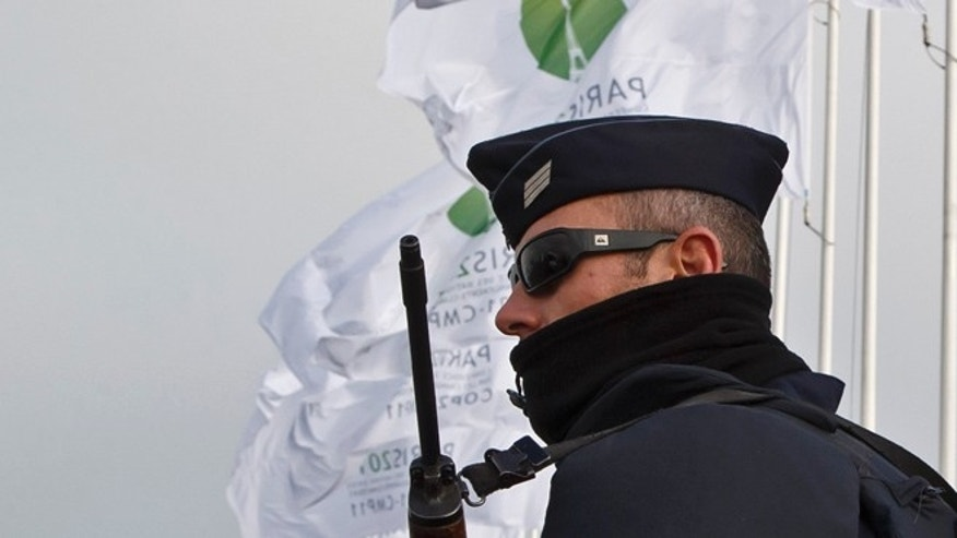 FILE: Nov. 27, 2015: A police officer outside the venue of the United Nations Climate Change Conference in Le Bourget, outside Paris, France.