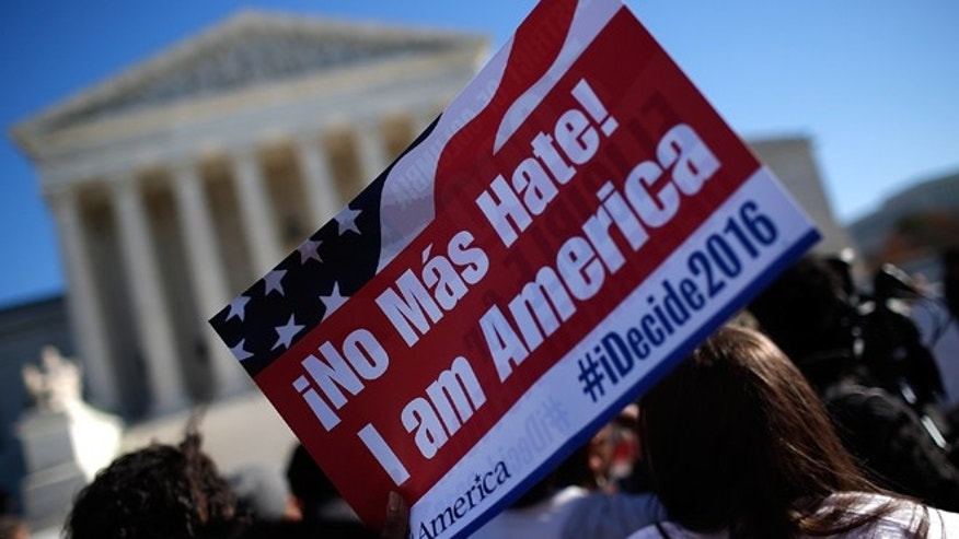 WASHINGTON, DC - NOVEMBER 20:  Supporters of immigration reform protest outside the U.S. Supreme Court November 20, 2015 in Washington, DC. The protesters demanded the implementation of U.S. President Barack Obama's immigration relief programs, including the Deferred Action for Parents of Americans and Lawful Permanent Residents and expanded Deferred Action for Childhood Arrivals, during the protest.  (Photo by Win McNamee/Getty Images)