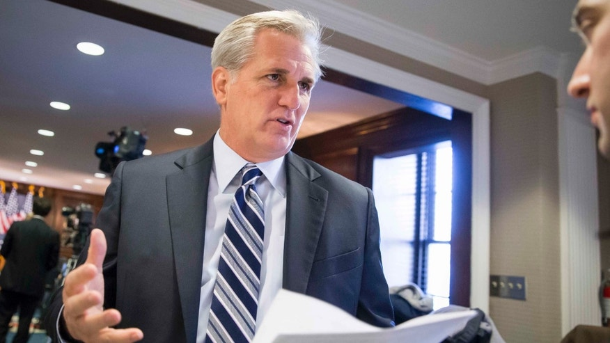 Majority Leader Kevin McCarthy, R-Calif., speaks with a reporter Tuesday, Dec. 8, 2015.