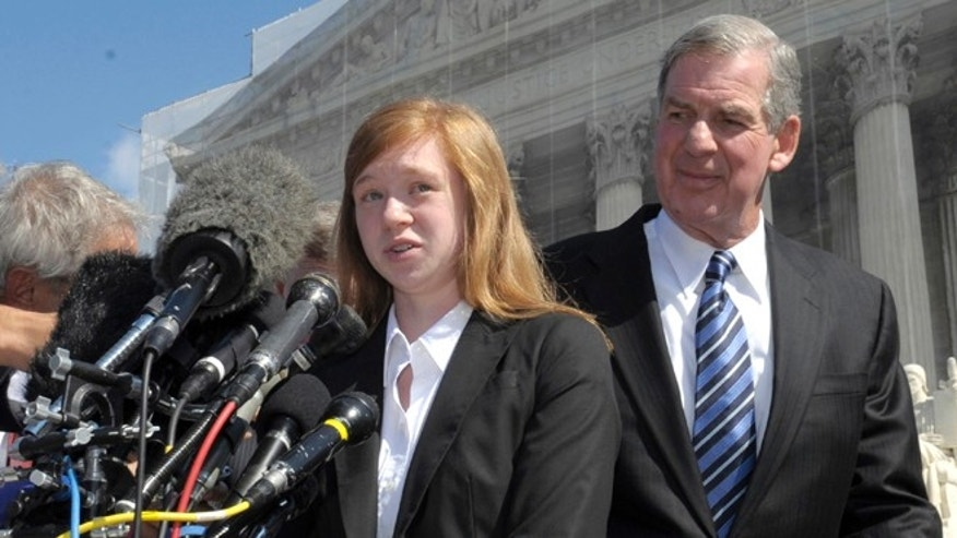 FILE - In this Oct. 10, 2012 file photo, Abigail Fisher, the Texan involved in the University of Texas affirmative action case, accompanied by her attorney Bert Rein, talks to reporters outside the Supreme Court in Washington.  Consideration of race in college admissions is again in line of fire at the Supreme Court Wednesday, for the second time in three years, in the case of a white Texas woman who was rejected for admission at the University of Texas.   (AP Photo/Susan Walsh)