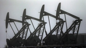 Dec. 19, 2014: Oil pump jacks are shown in Williston, N.D.
