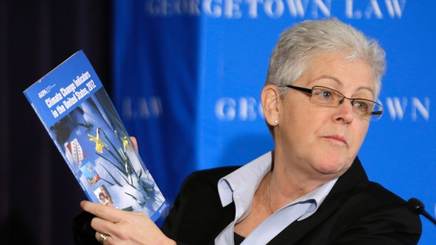 Gina McCarthy, Assistant Administrator with the Environmental Protection Agency, holds a climate change report as she speaks at a climate workshop sponsored by The Climate Center at Georgetown University, Thursday, Feb. 21, 2013 in Washington. President Barack Obama is poised to nominate McCarthy as head of the powerful Environmental Protection Agency. McCarthy, who currently heads the EPA's Office of Air and Radiation, reportedly has the inside track to replace Lisa Jackson, who officially stepped down from the agency last week. (AP Photo/Alex Brandon)