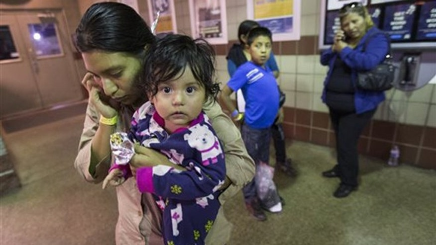 Judy Martinez tries to reach family after being released by ICE at a Greyhound Bus station in Phoenix, May 28, 2014.