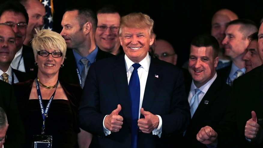 Republican presidential candidate, Donald Trump flashes thumbs up after being endorsed at a regional police union meeting in Portsmouth, N.H., Thursday, Dec. 10, 2015. (AP Photo/Charles Krupa)