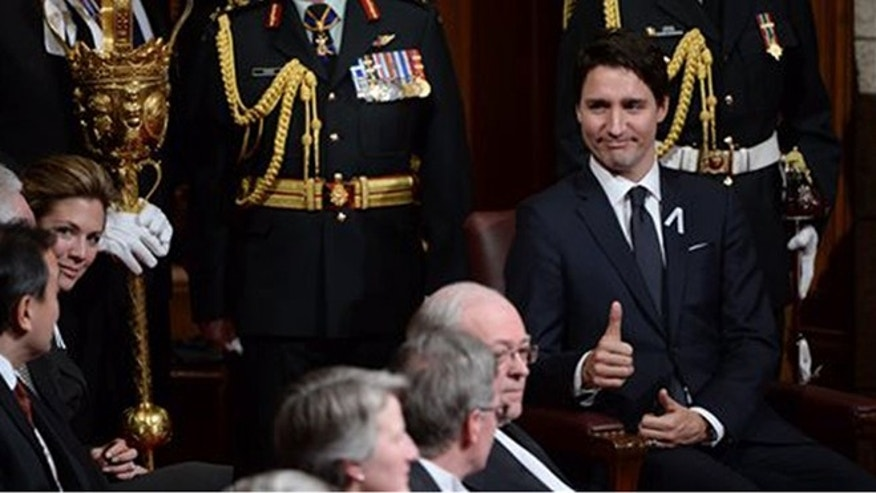 Prime Minister Justin Trudeau gives a thumbs-up before the Speech from the Throne in the Senate Chamber on Parliament Hill in Ottawa, Friday, Dec. 4, 2015. (Sean Kilpatrick/The Canadian Press via AP)