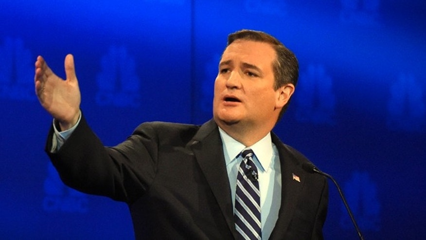 In this Oct. 28, 2015, photo, Republican presidential candidate Sen. Ted Cruz, r-Texas, talks about the mainstream media during the CNBC Republican presidential debate at the University of Colorado in Boulder, Colo. Cruz says the U.S. adopt a European-style value added tax, adding to a division in the Republican presidential field. Some simply want to cut existing tax rates. But Cruz is among those who suggests scrapping the nation's tax code entirely and starting from scratch.  (AP Photo/Mark J. Terrill)