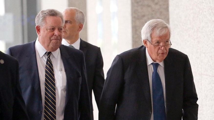 FILE - In this June 9, 2015, file photo, former House Speaker Dennis Hastert, right, departs the federal courthouse with his attorney Thomas C. Green in Chicago, after his arraignment on federal charges that he broke federal banking laws and lied about the money when questioned by the FBI. Attorneys are expected to return to federal court Thursday, June 18  2015, to set a schedule for how Hastert's case will proceed. The indictment alleges Hastert agreed to pay $3.5 million to someone from his days as a high school teacher not to reveal a secret about past misconduct. (AP Photo/Charles Rex Arbogast, File)