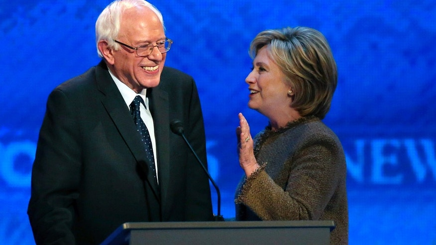 Dec. 19, 2015: Hillary Clinton, right, speaks to Bernie Sanders during a break at the Democratic presidential primary debate at Saint Anselm College in Manchester, N.H.