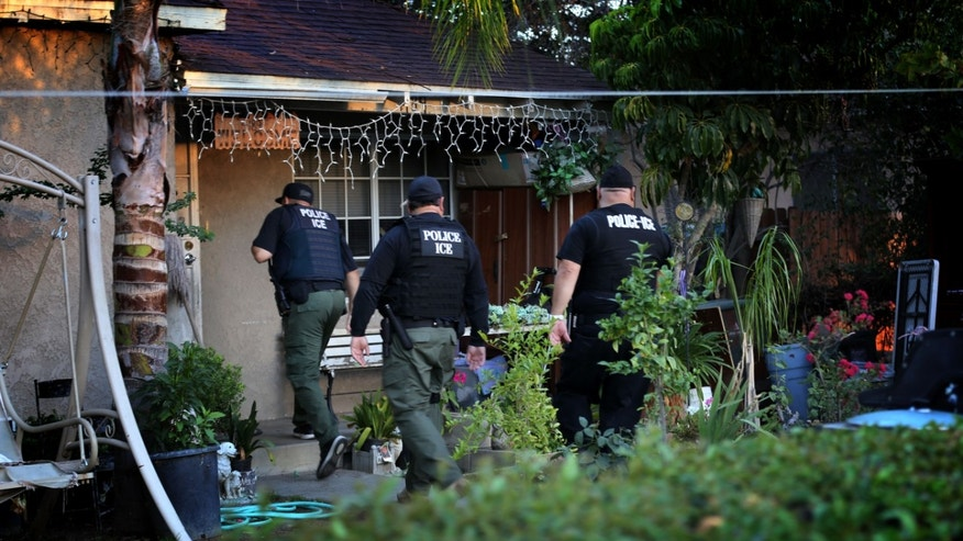 RIVERSIDE, CA - AUGUST 12: ICE Enforcement and Removal Operations unit raid to apprehend immigrants without any legal status and who may be deportable. (Irfan Khan/Los Angeles Times via Getty Images)