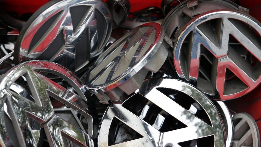 Sept. 23, 2015: Volkswagen ornaments sit in a box in a scrap yard in Berlin, Germany.