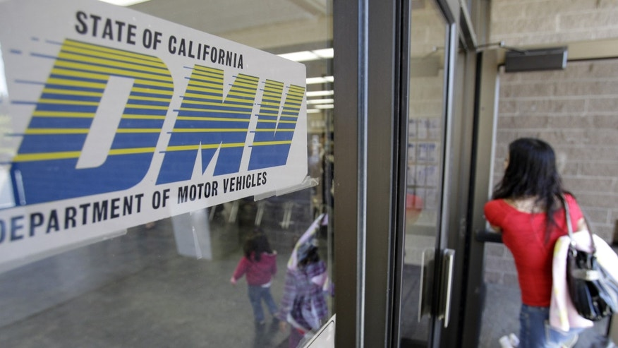 FILE - In this June 30, 2011 file photo, a customer walks into a Department of Motor Vehicles office in Redwood City, Calif. The U.S. Department of Homeland Security has granted a last-minute extension giving the state of California more time to comply with a federal Real ID Act, which sets stricter standards on identification. The state Department of Motor Vehicles announced Wednesday, Dec. 30, 2015, that the federal agency would have until Oct. 10, 2016 to comply with the rules. (AP Photo/Paul Sakuma, File)
