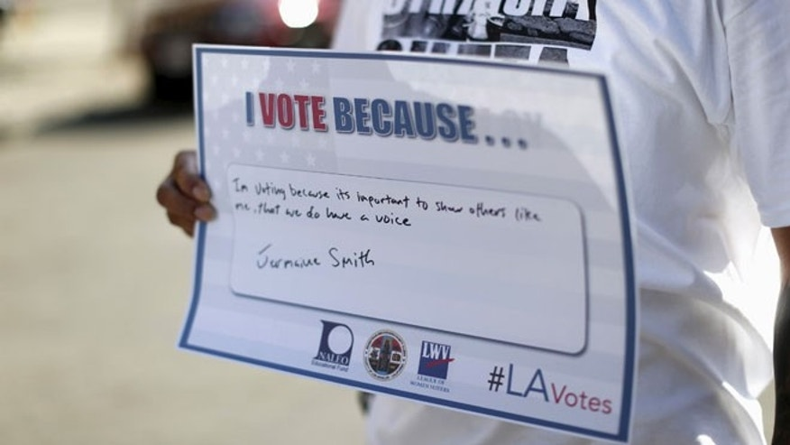 FILE: Sept. 22, 2015: A person holds a sign after registering to vote during National Voter Registration Day in Los Angeles, Calif. (Reuters)