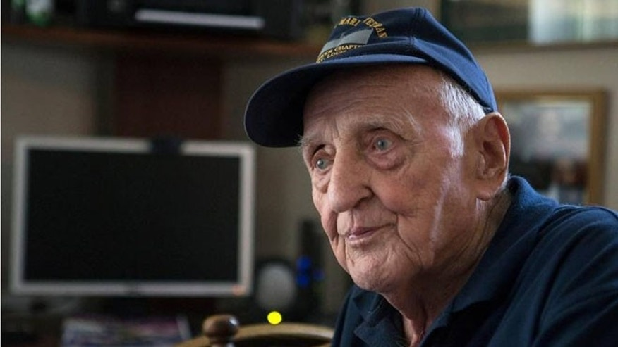 FILE: August 2015: Orville Sova, of Collinsville, Ill., served in the U.S. Merchant Marine during WWII. He was 88 when this picture was taken. He died Nov. 6, 2015. (Derik Holtmann of the Belleville (Ill.) News-Democrat.)