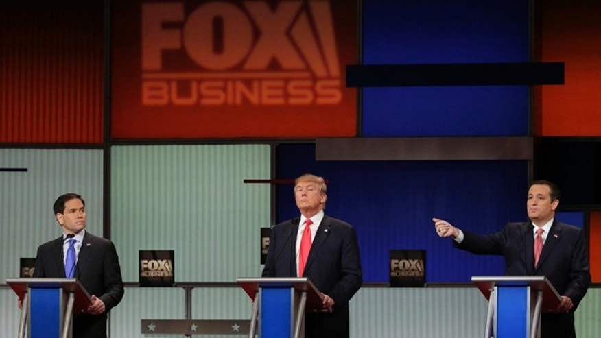 Republican presidential candidate, Sen. Ted Cruz, R-Texas, left, speaks as Republican presidential candidate, Sen. Marco Rubio, R-Fla., left, and Republican presidential candidate, businessman Donald Trump look on during the Fox Business Network Republican presidential debate at the North Charleston Coliseum, Thursday, Jan. 14, 2016, in North Charleston, S.C. (AP Photo/Chuck Burton)