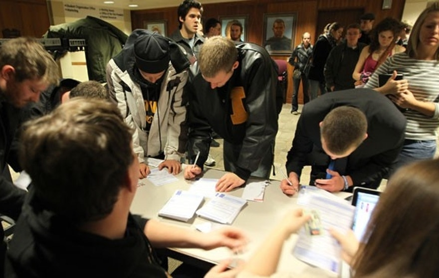 Caucus voters filling out same-day voter registration paperwork to participate in the 2012 Republican presidential caucus in Iowa