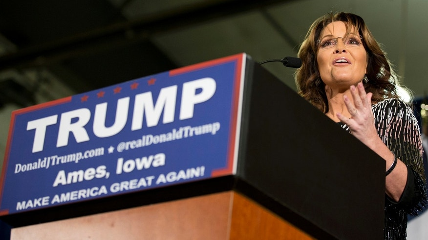 Jan. 19, 2016: Former Alaska Gov. Sarah Palin, left, endorses Republican presidential candidate Donald Trump during a rally at Iowa State University in Ames. (AP Photo/Mary Altaffer)
