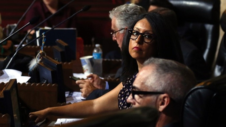 Council member Nury Martinez and the rest of the Los Angeles City Council discuss and vote to approve the permit process that would allow Uber and Lyft to apply to gain access to Los Angeles International Airport for picking up fares. ( Rick Loomis / Los Angeles Times via Getty Images )