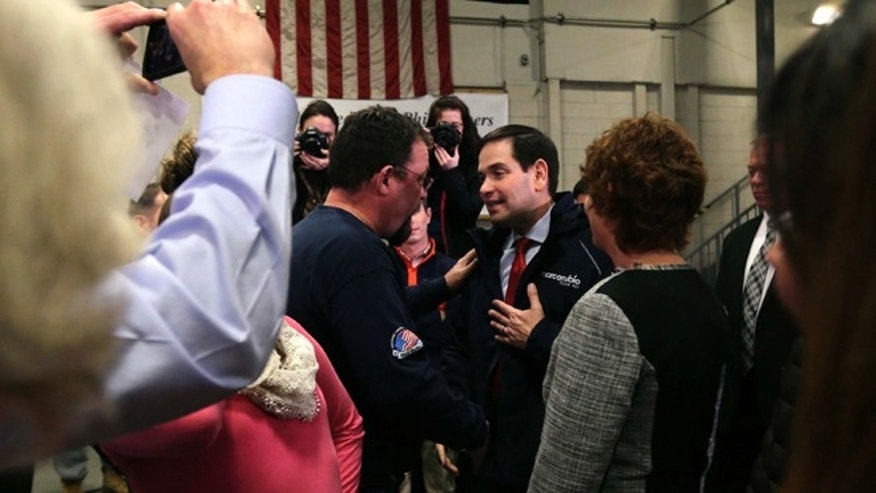 In this Jan. 21, 2016, photo Republican presidential candidate, Sen. Marco Rubio, R-Fla., talks with Bob Belanger, from Brookline, N.H., after a campaign stop at a welding company in Brookline. Illegal immigration is a paramount concern to New Hampshire voters, and Republican presidential candidates are being faced with tough questions from voters in this small, mostly white, state on how they will handle the issue if elected. Belanger said immigration concerns among New Hampshire residents do not equate to xenophobia. (AP Photo/Charles Krupa)