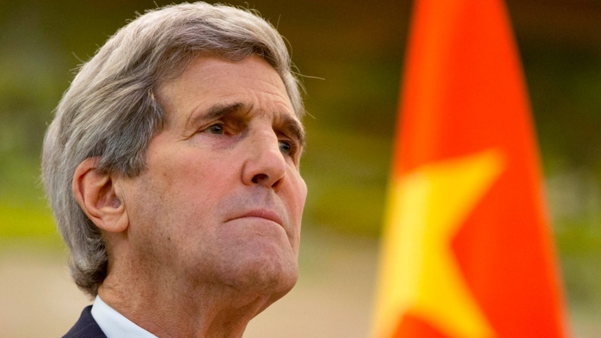 Jan. 27, 2016: U.S. Secretary of State John Kerry listens to an opening statement by Chinese Foreign Minister Wang Yi during a news conference at the Ministry of Foreign Affairs in Beijing on the final leg in Kerry's latest round-the-world diplomatic mission.