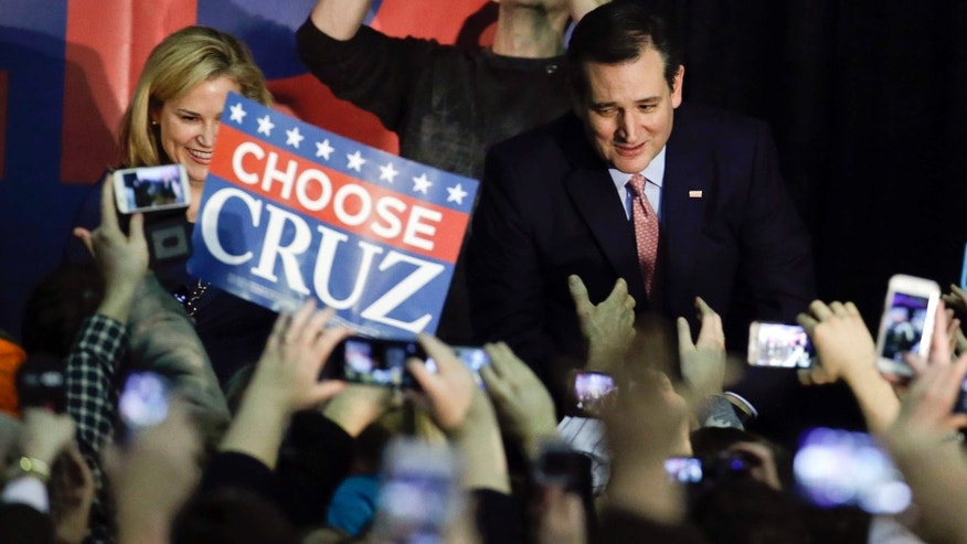 Republican presidential candidate, Sen. Ted Cruz, R-Texas, arrives for a caucus night rally, Monday, Feb. 1, 2016, in Des Moines, Iowa. Cruz sealed a victory in the Republican Iowa caucuses, winning on the strength of his relentless campaigning and support from his party's diehard conservatives. (AP Photo/Chris Carlson)