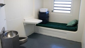 A jail cell is seen in the Enhanced Supervision Housing Unit at the Rikers Island Correctional facility in New York March 12, 2015. New York City is proposing to reduce violence among inmates at its troubled Rikers Island jail by limiting visitors, adding security cameras and separating rival gangs, Mayor Bill de Blasio announced on Thursday. REUTERS/Brendan McDermid (UNITED STATES - Tags: CRIME LAW CIVIL UNREST) - RTR4T5PW