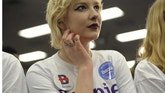 Alli Scholl, a supporter of U.S. Democratic presidential candidate Bernie Sanders, listens as he speaks at a campaign rally in Waterloo, Iowa January 31, 2016. REUTERS/Mark Kauzlarich - RTX24U58