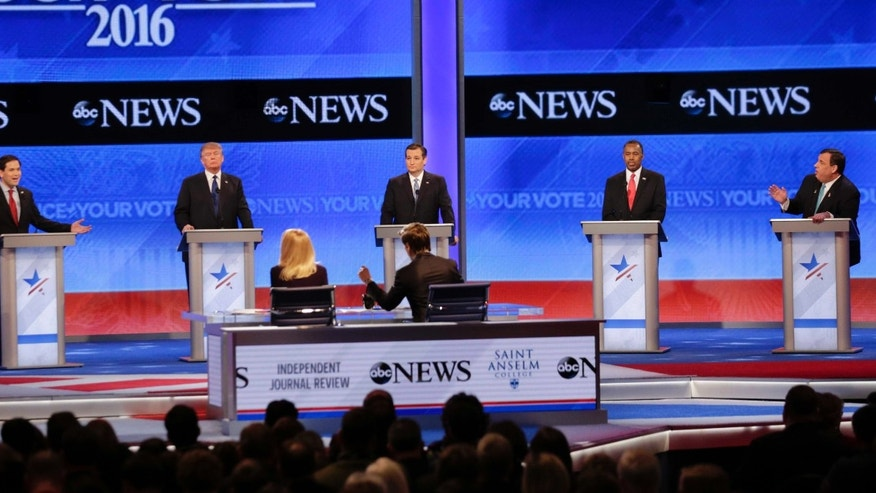 Republican presidential candidate, Sen. Marco Rubio, R-Fla., left, spars with Republican presidential candidate, New Jersey Gov. Chris Christie, right as Republican presidential candidate, businessman Donald Trump, Republican presidential candidate, Sen. Ted Cruz, R-Texas, and Republican presidential candidate, retired neurosurgeon Ben Carson  listen during a Republican presidential primary debate hosted by ABC News at the St. Anselm College  Saturday, Feb. 6, 2016, in Manchester, N.H. (AP Photo/David Goldman)