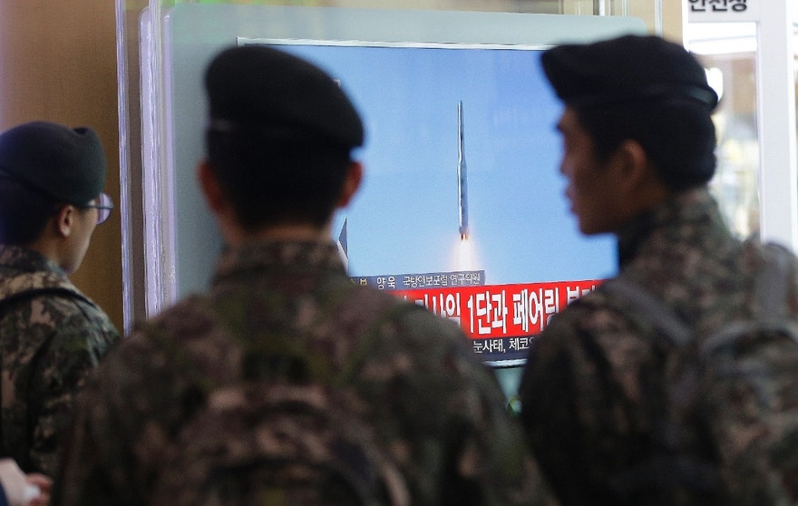 South Korean army soldiers watch a TV news program with a file footage about North Korea's rocket launch at Seoul Railway Station in Seoul, South Korea, Sunday, Feb. 7, 2016. North Korea on Sunday defied international warnings and launched a long-range rocket that the United Nations and others call a cover for a banned test of technology for a missile that could strike the U.S. mainland. (AP Photo/Ahn Young-joon)