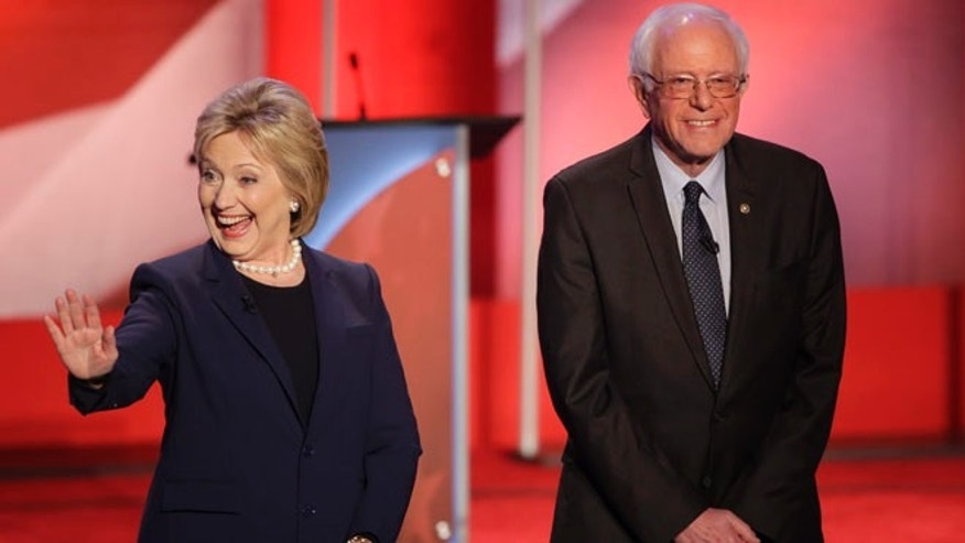 Democratic presidential candidate, Hillary Clinton and Democratic presidential candidate, Sen. Bernie Sanders, I-Vt,  greet the audience before a Democratic presidential primary debate hosted by MSNBC at the University of New Hampshire Thursday, Feb. 4, 2016, in Durham, N.H. (AP Photo/David Goldman)